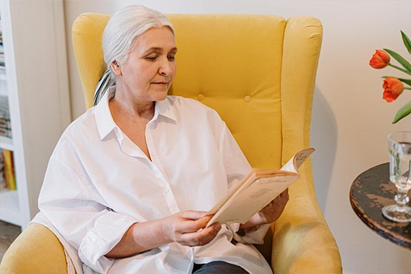 Senior Patient Reading Before Dental Appointment